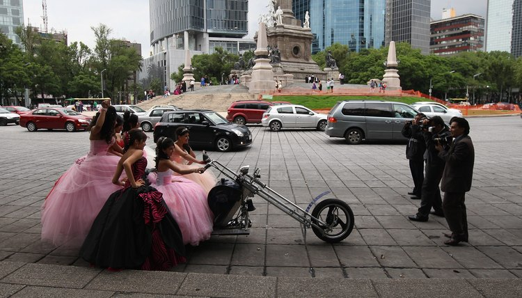Quinceanera girls pose on a chopper in Mexico City