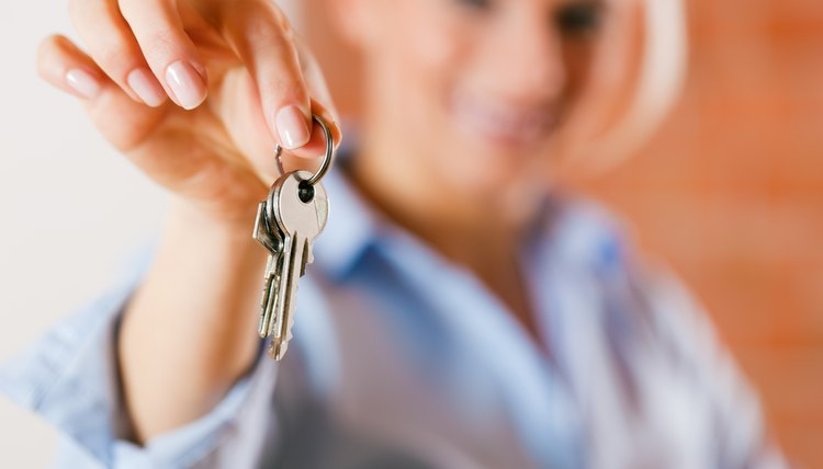 Realtor in empty apartment giving keys