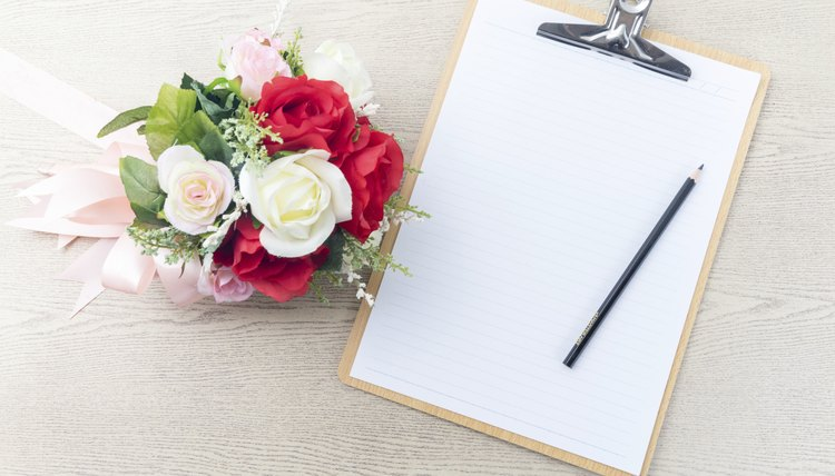 A clipboard, paper and pencil are the primary tools for writing wedding sermons.