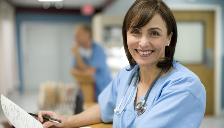 Female Doctor Holding Medical Records, Smiling, Portrait