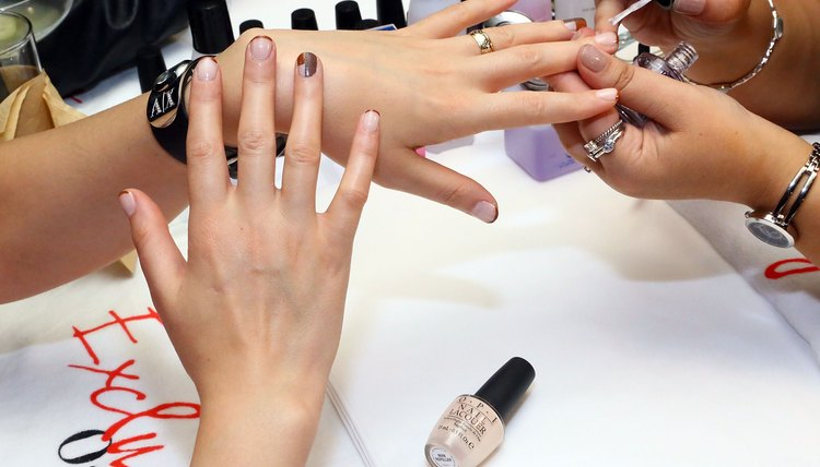 Jazz up a regular manicure by embellishing with loose glitter.