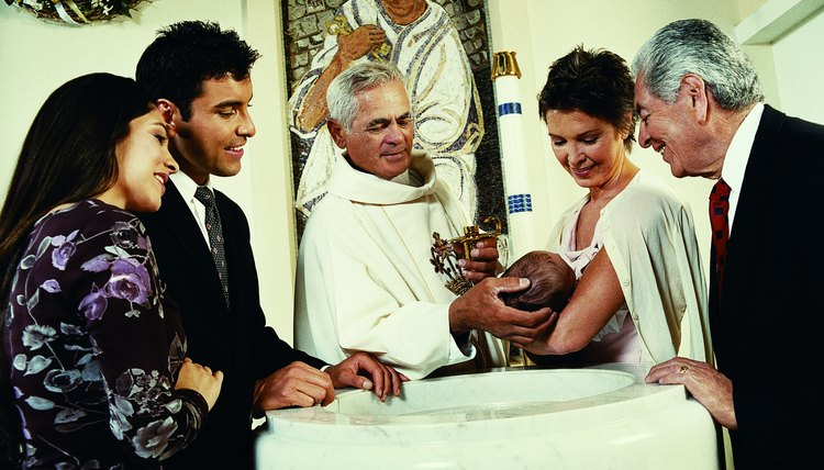 Blessed olive oil is dripped onto the baby's head during baptism.