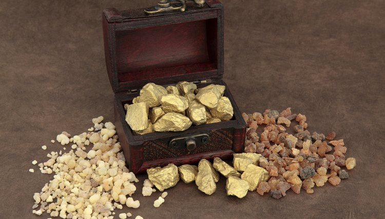 Gold, frankincense and myrrh in an old wooden box.