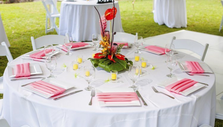 The natural landscape invites crisp linens and fresh flowers on the tables.