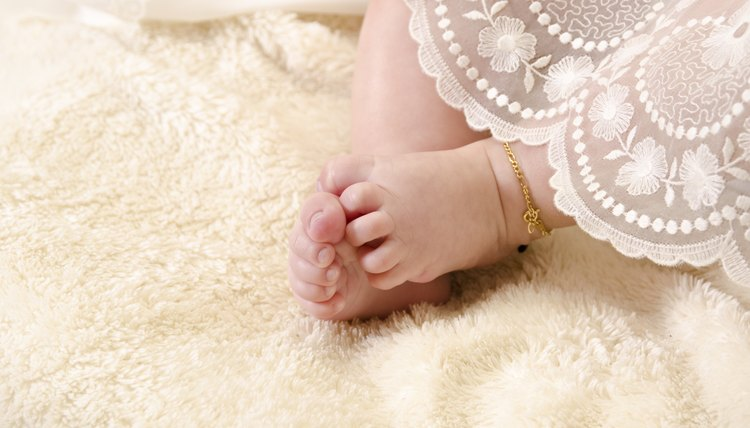 Baptism clothing covering baby's legs.