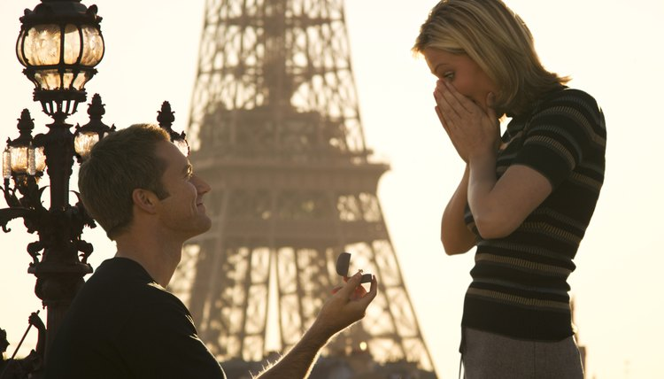 Man proposing to wife in front of the Eiffel Tower.