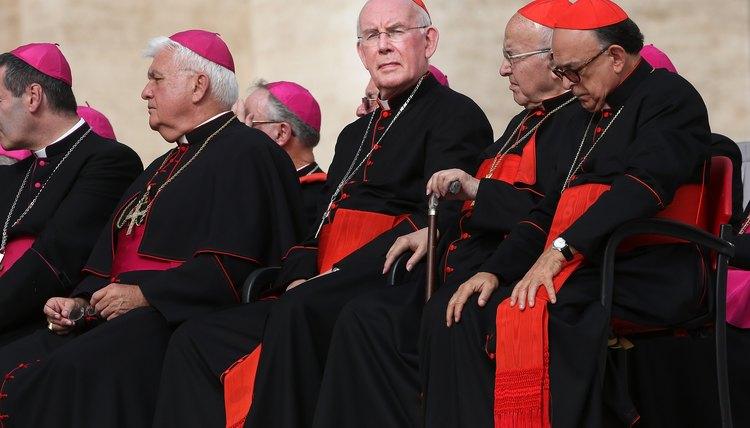 A cardinal attending a public ceremony.