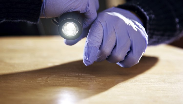 A forensic scientist collects evidence from a crime scene.