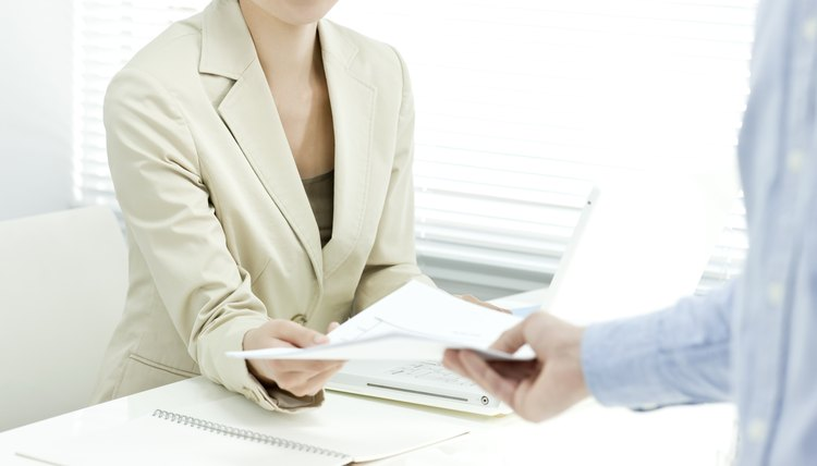 The businesswoman who receives documents