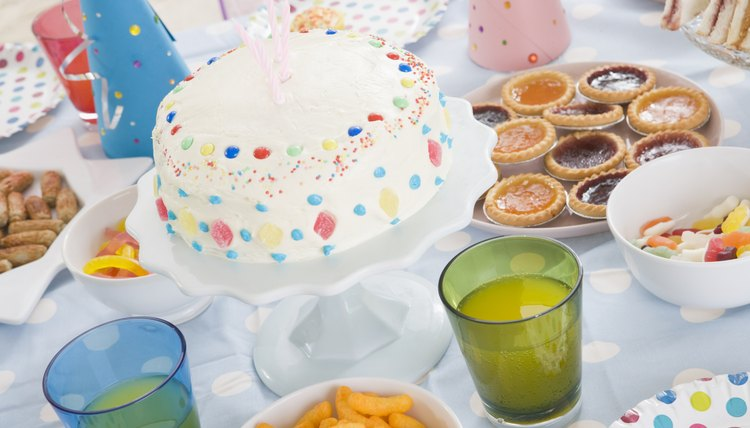 Make a rainbow cake to help your 2-year-old learn colors.