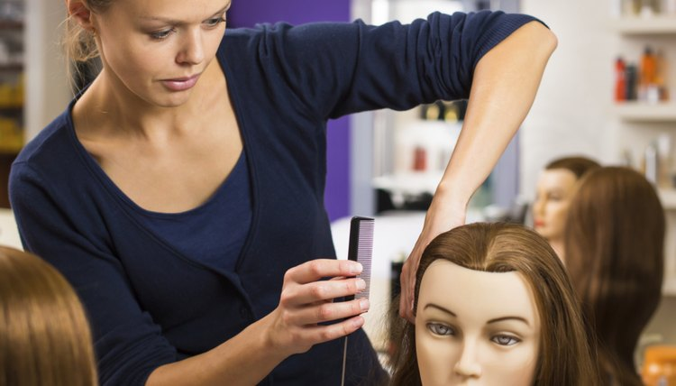 An apprentice practices on a mannequin.