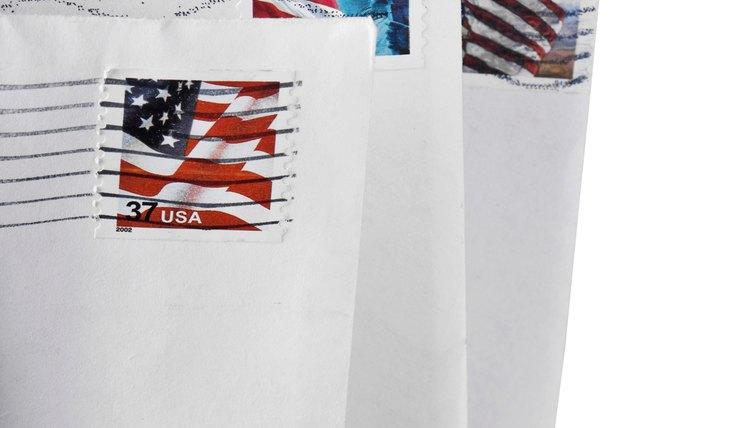 Stamps on white envelopes.