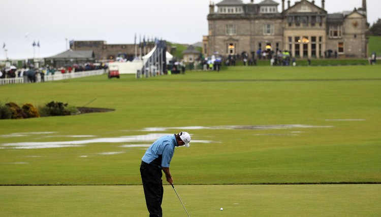 Lee Westwood putts on the first green of the Old Course at St. Andrews in 2011.