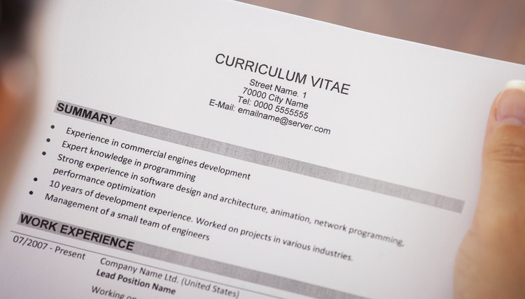 Young Businesswoman Reading Curriculum Vitae