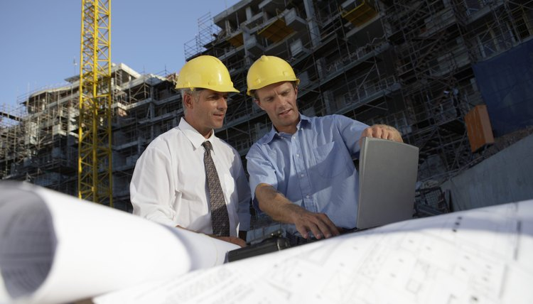 Construction managers oversee operations at a building site.