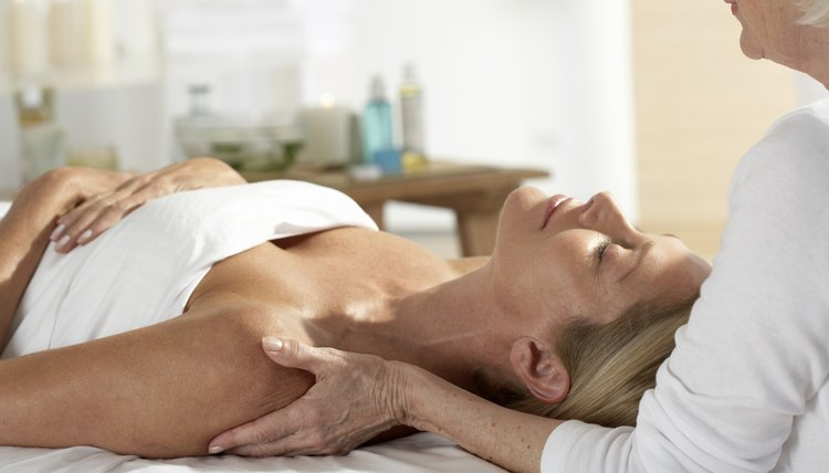 Woman laying on table having a massage