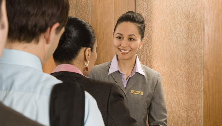 Hotel employee and guests