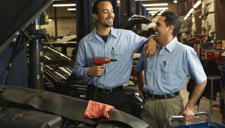 Car repair employees in garage.