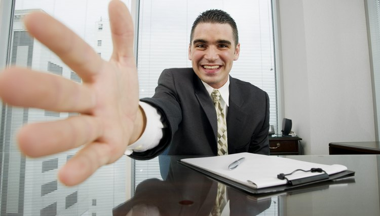 Close-up of businessman extending hand