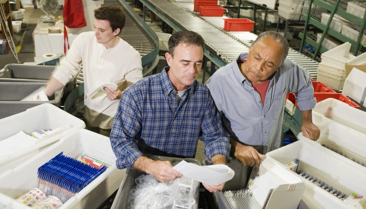 Warehouse workers inspecting packages