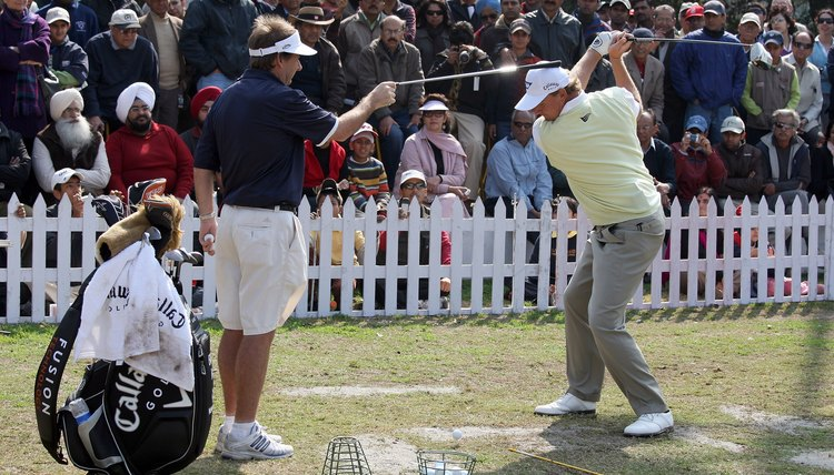 Even Ernie Els uses his caddie on the driving range in a drill that reminds him to keep his head still through the swing.