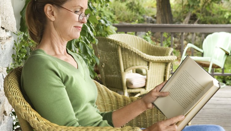 Woman reading from book.