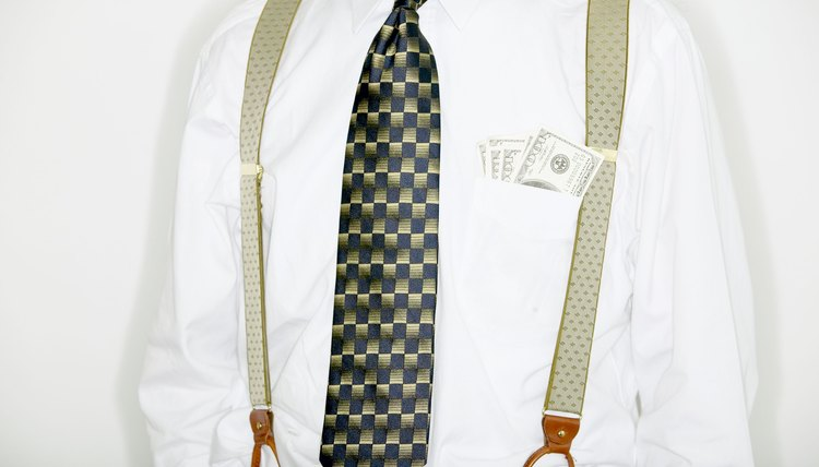 Businessman with cash in pocket