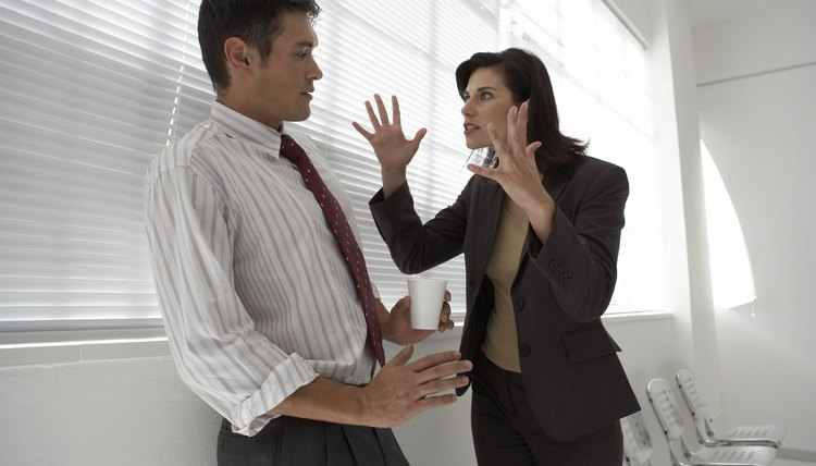 Businesswoman yelling at a businessman