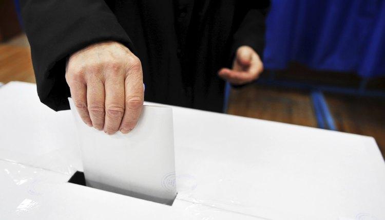 Man dropping vote into ballot box
