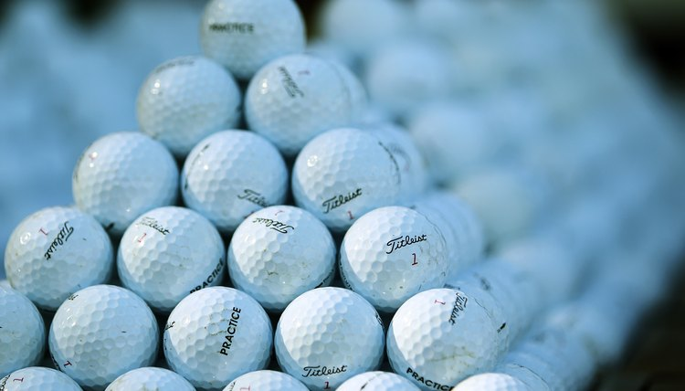The golf ball has undergone many enhancements over the years from the original wooden ball to the modern rubber core.