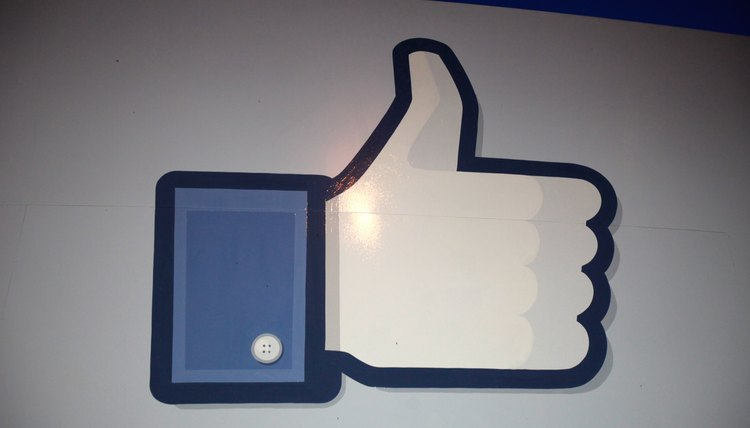 Get the code for the Facebook Like button from the Facebook Developers website.