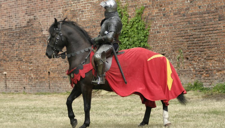 Medieval knights riding a horse.