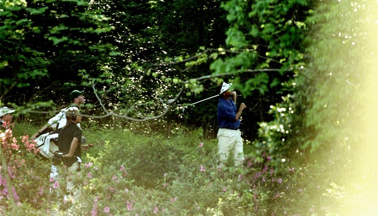 Even pro golfers hook the ball, as Fred Couples did on the 18th tee during the 1998 Masters, leaving him in the woods.