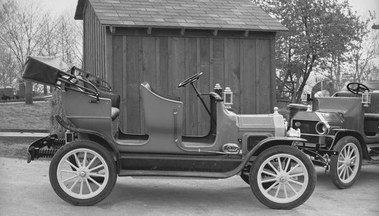 Gas engines replaced the earliest steam models in late-19th-century automobiles.