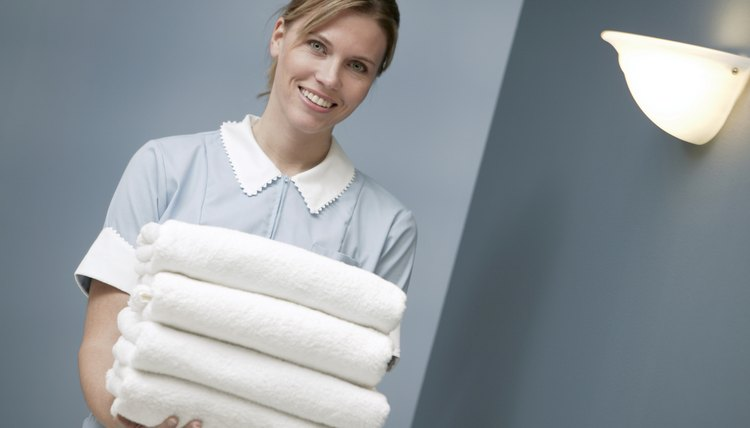 Maid holding towels