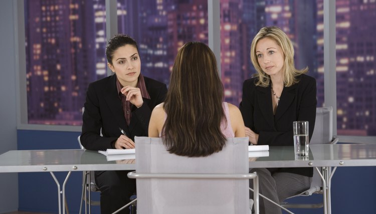 Businesswomen interviewing woman