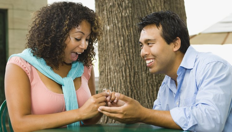 Traditionally a man proposes to a woman.
