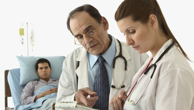 Male doctor and a female doctor discussing a report