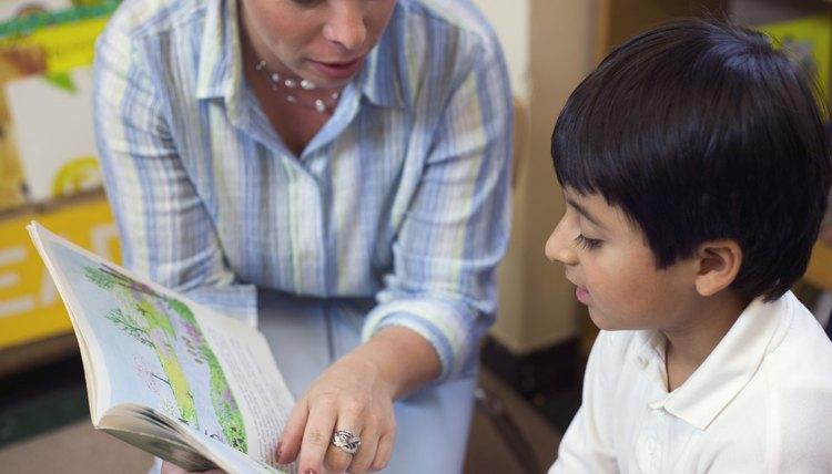 Kindergarten students learn pre-reading skills.