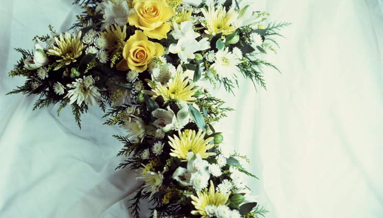 Include a handwritten note of sympathy in the funeral flower arrangement.