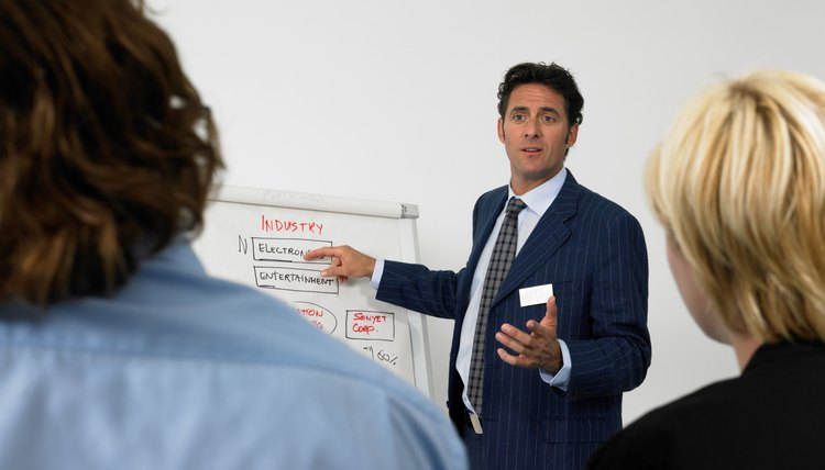 Businessman giving presentation pointing to flipchart