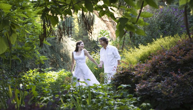 Couple walking through garden