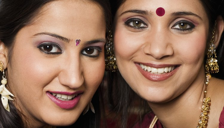 2 young Indian women smiling.