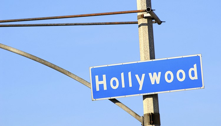 Close-up of a blue street sign on a lamppost for Hollywood.