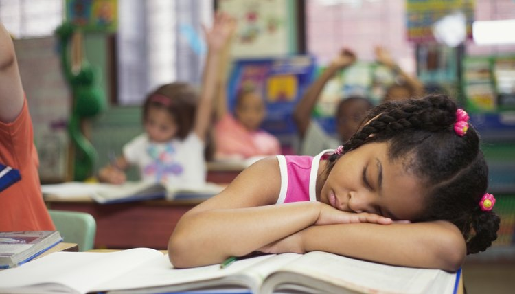 Kids who fall asleep in class often aren't bored, but aren't getting enough sleep at home.