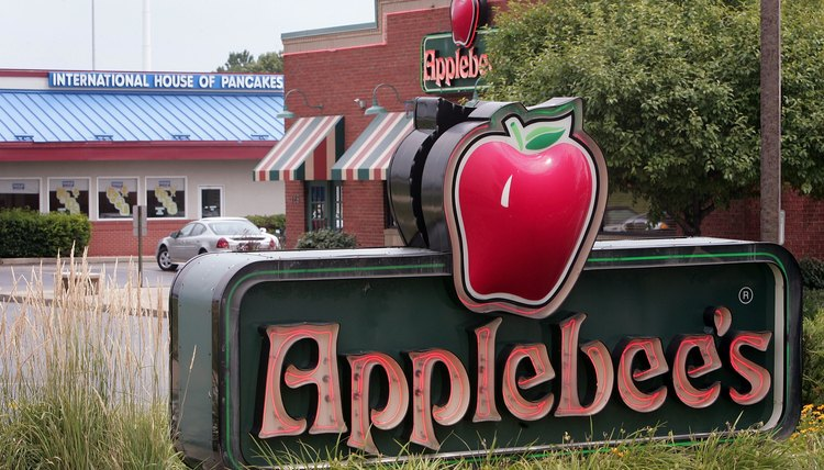 An Applebee's sign in front of a restaurant location