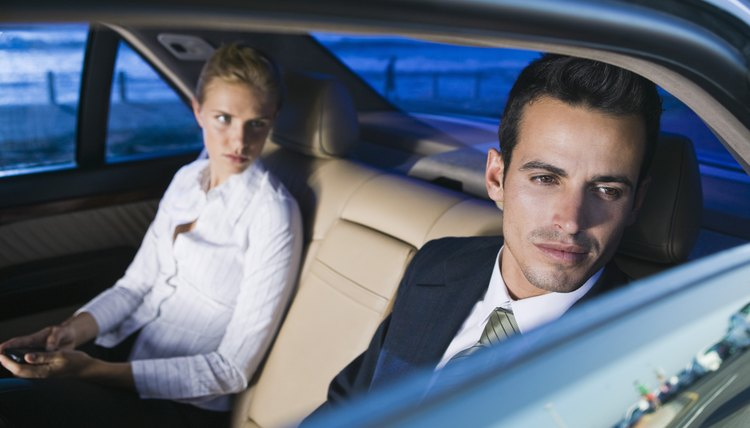 Businesspeople in backseat of car
