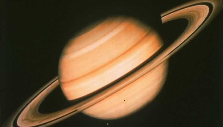 Cold temperatures characterize the ringed planet's outer atmosphere.