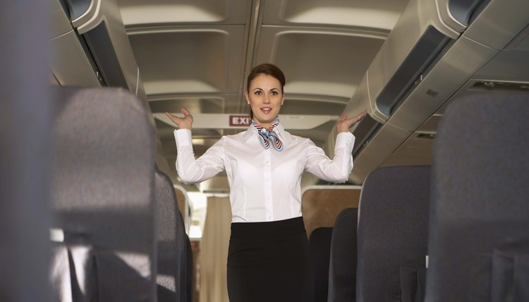The stewardess keeps passengers contented during their flight.