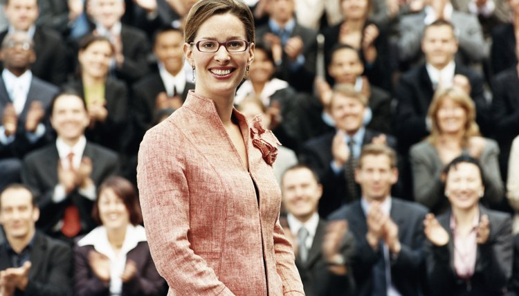 Female CEO Standing in Front of a Large Group of Business People
